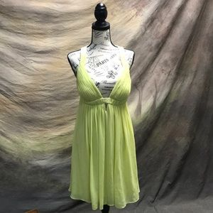 Green cocktail dress. Cache'.  Size 8